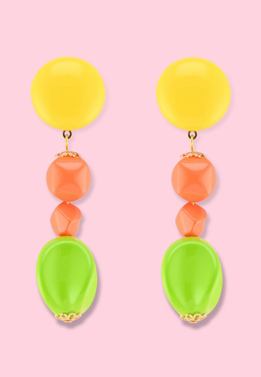 Large statement drop earrings with clip-on closing, by live-to-express. Shop sustainable vintage earrings online.