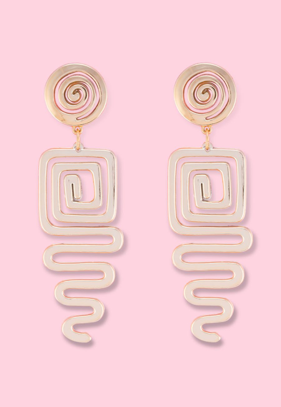 Golden vintage drop earrings by live-to-express. Shop 90's vintage statement earrings online.