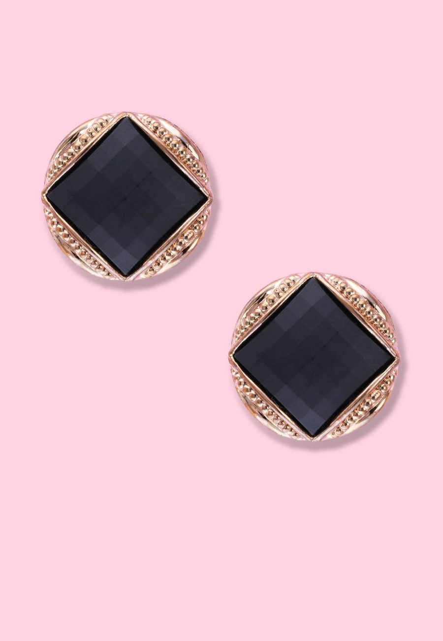 Black and gold vintage clip-on stud earrings, by live-to-express. Online 80's vintage earrings shop.