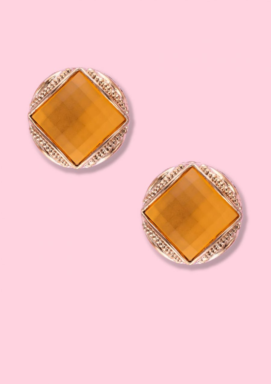 Yellow and gold vintage clip-on stud earrings, by live-to-express. Online 80's vintage earrings shop.
