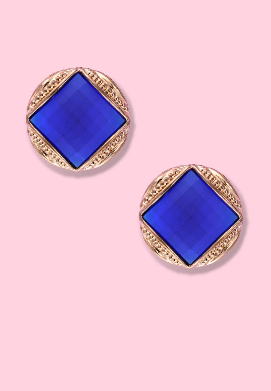 Blue and gold vintage clip-on stud earrings, by live-to-express. Online 80's vintage earrings shop.