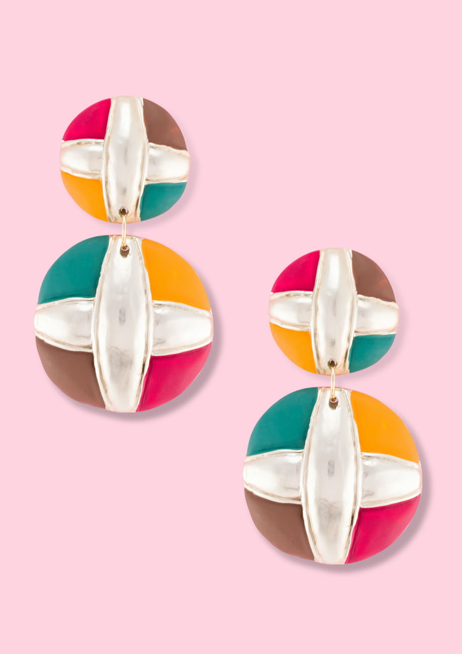 Round bold multi coloured vintage earrings by live-to-express. Shop vintage clip-on earrings online.