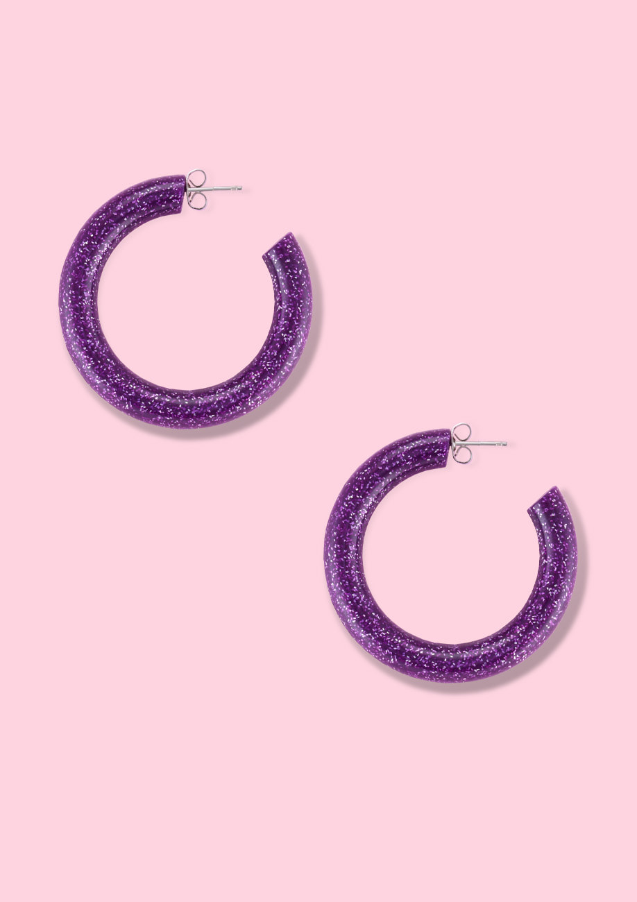 Purple glitter hoop earrings, by live-to-express. Shop earrings online at live-to-express.