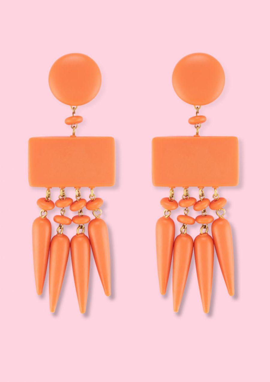 Orange statement earrings by live-to-express. Shop 70's vintage earrings online.