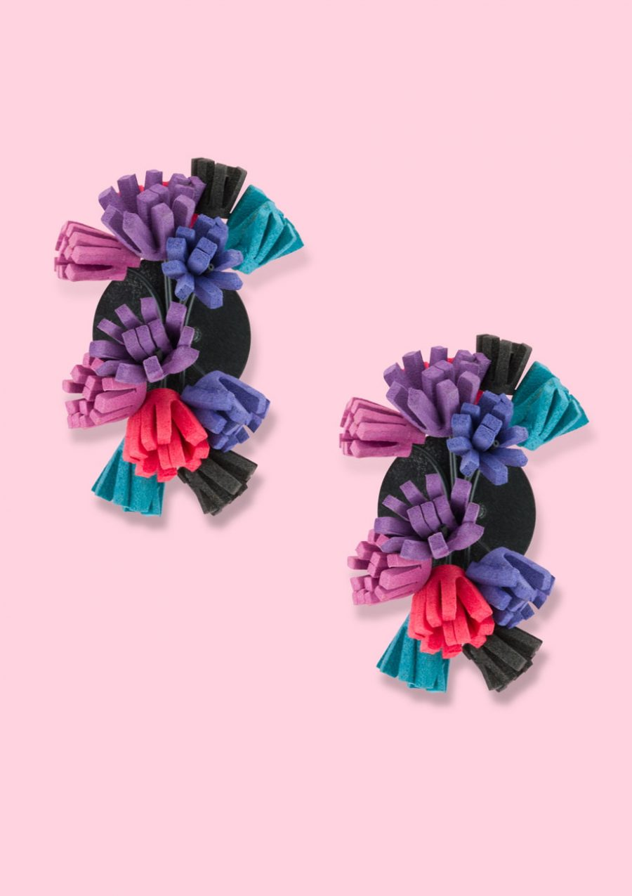 Purple statement earrings with foam fringes and a clip closing