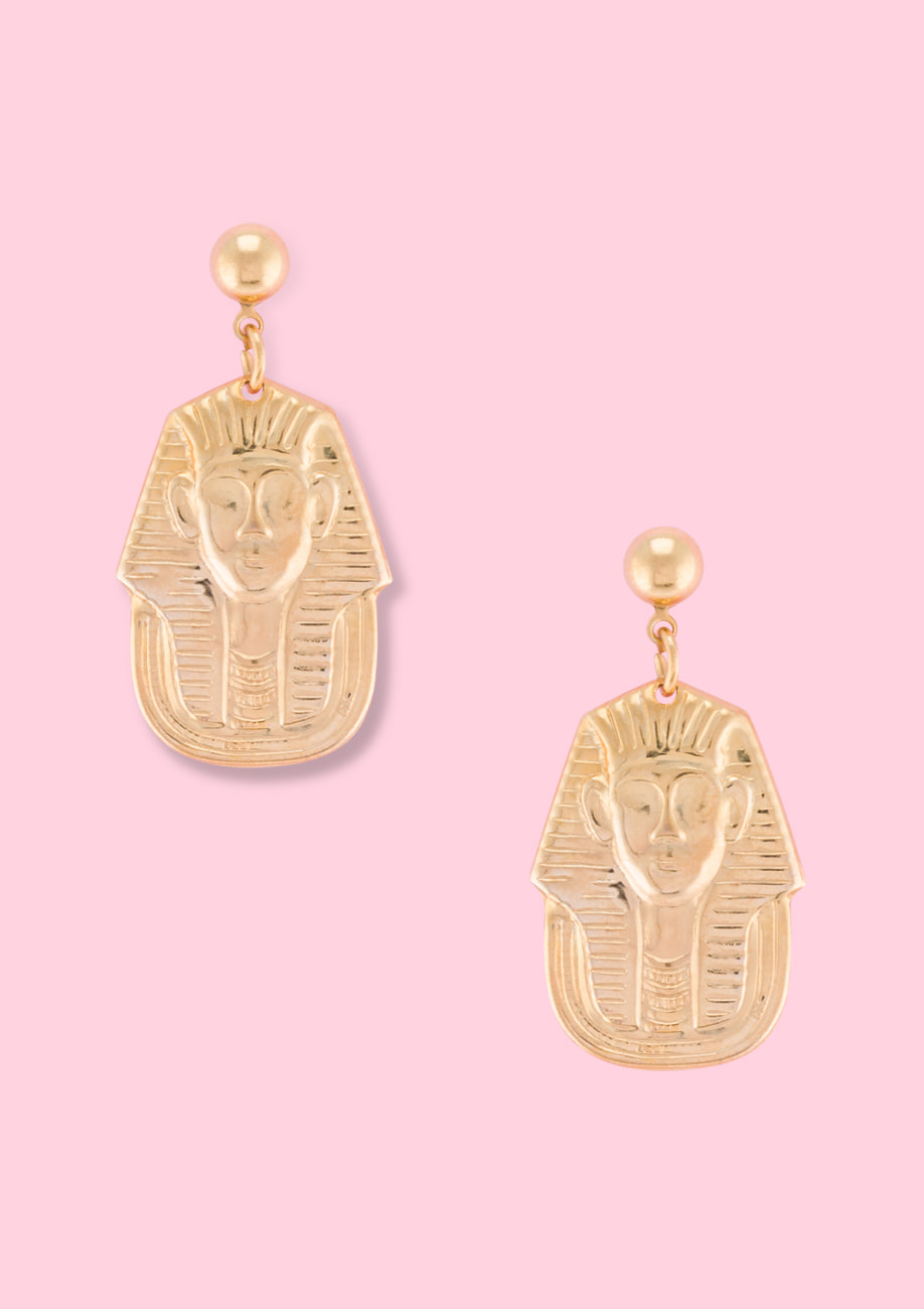 Golden pharaoh drop earrings by live-to-express. Shop 90's vintage ear jewellery online.