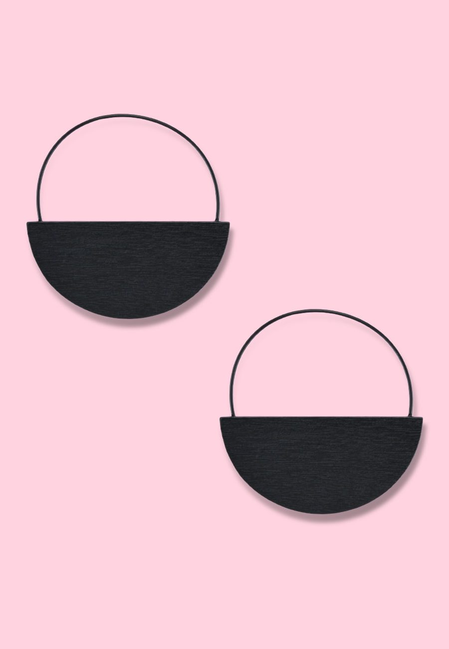Round black wooden earrings by live-to-express. Shop vintage wooden earrings online.