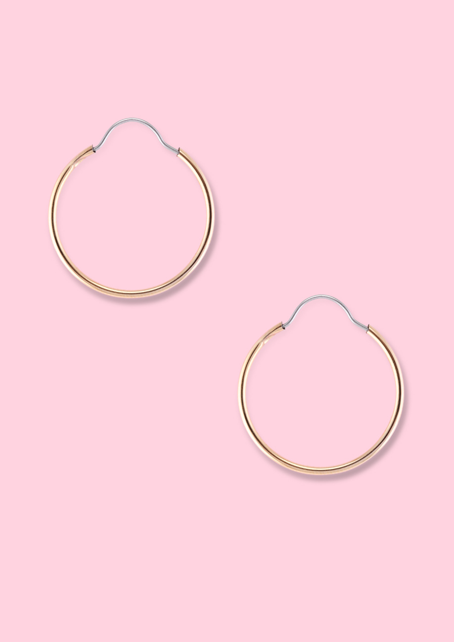 Small golden hoop earrings by live-to-express. Shop sustainable vintage online at live-to-express.