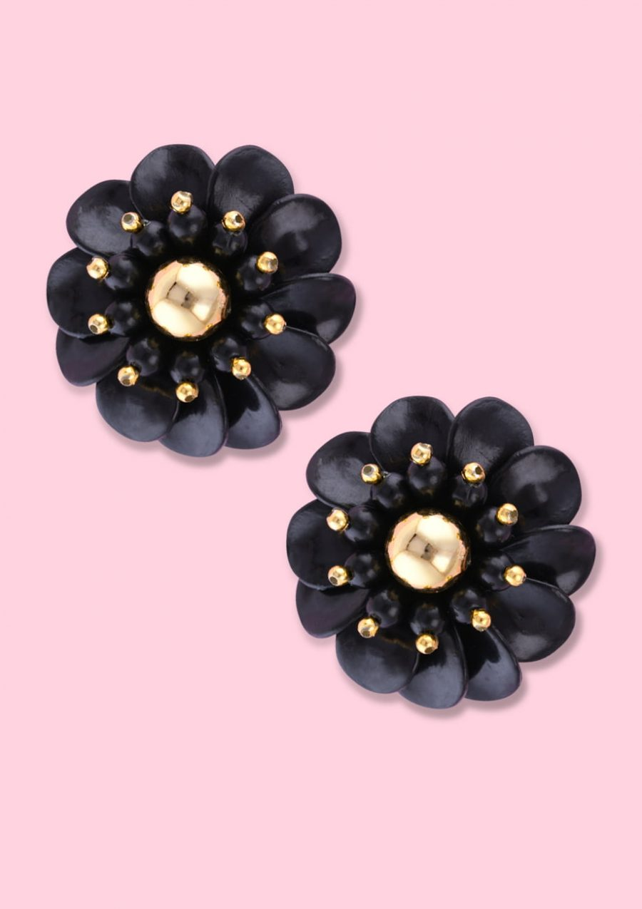 Black flower earring with clip-on closing, by live-to-express. Shop vintage earrings online.