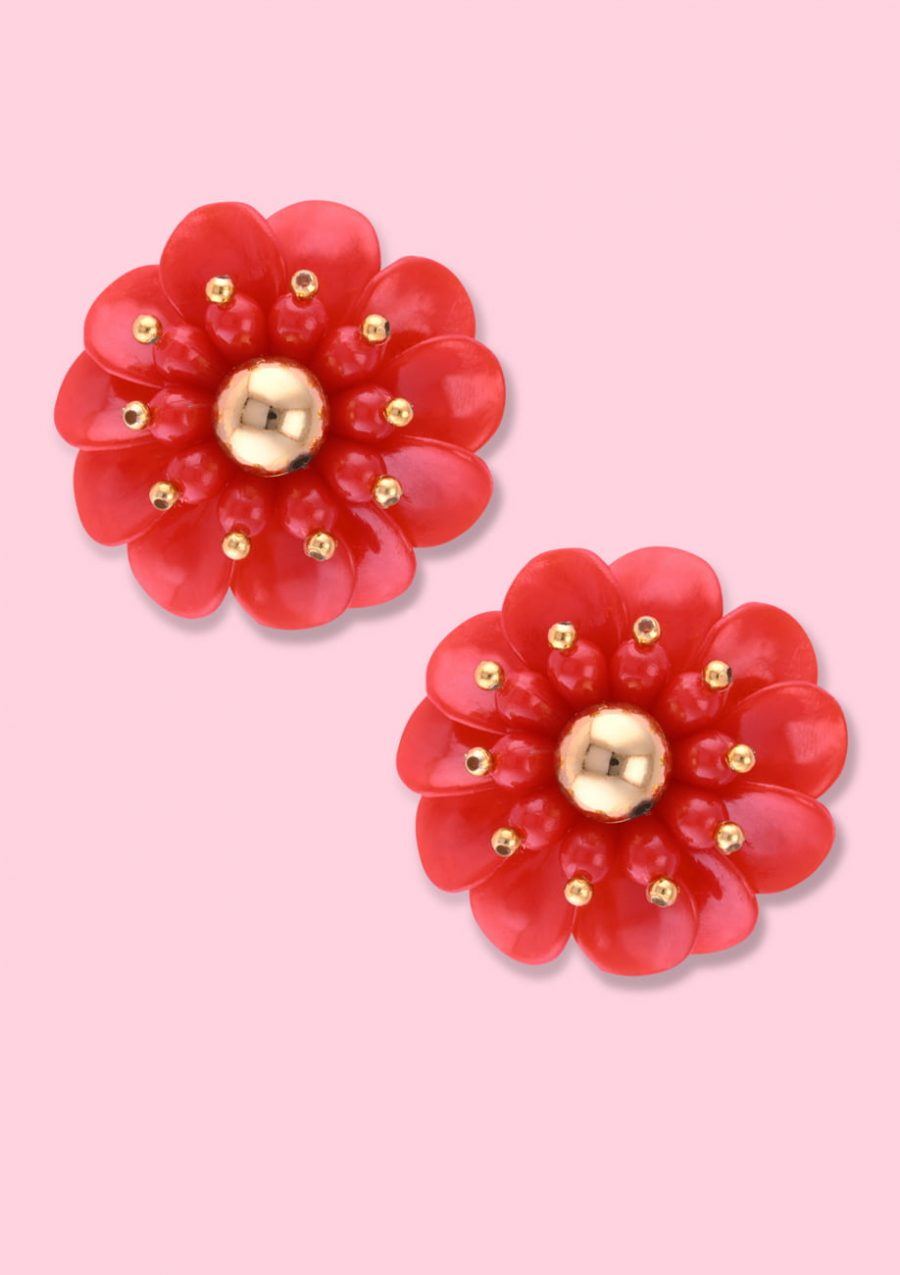 Red flower earring with clip-on closing, by live-to-express. Shop vintage earrings online.