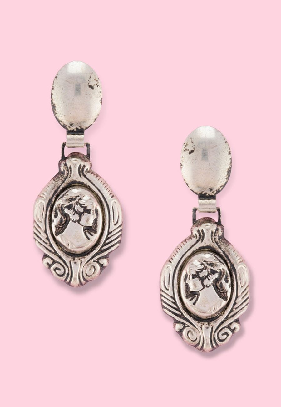 Silver medallion drop earrings with push-back closing, by live-to-express. Shop 60's vintage earrings online.