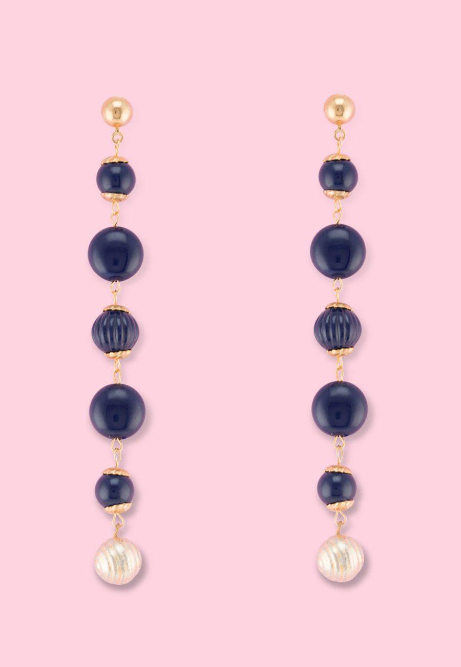 Blue vintage dangle earrings by live-to-express. Shop vintage push-back earrings online.