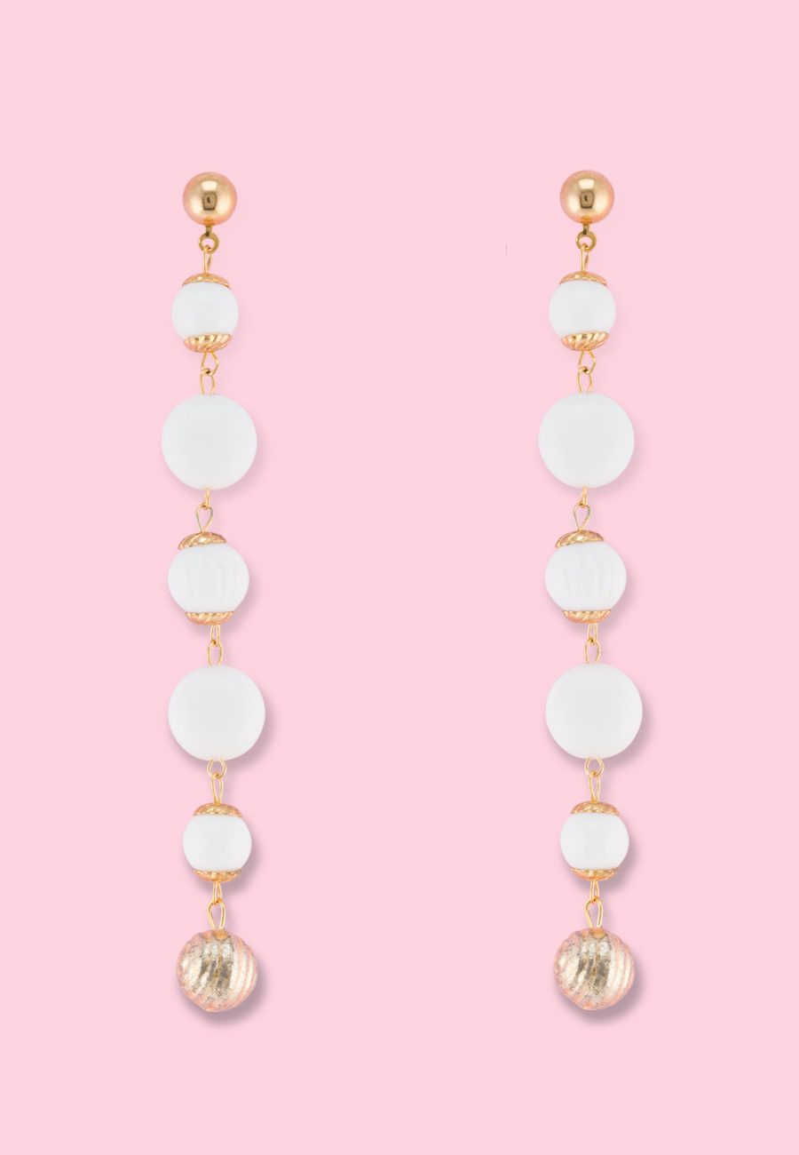 White vintage dangle earrings by live-to-express. Shop vintage push-back earrings online.