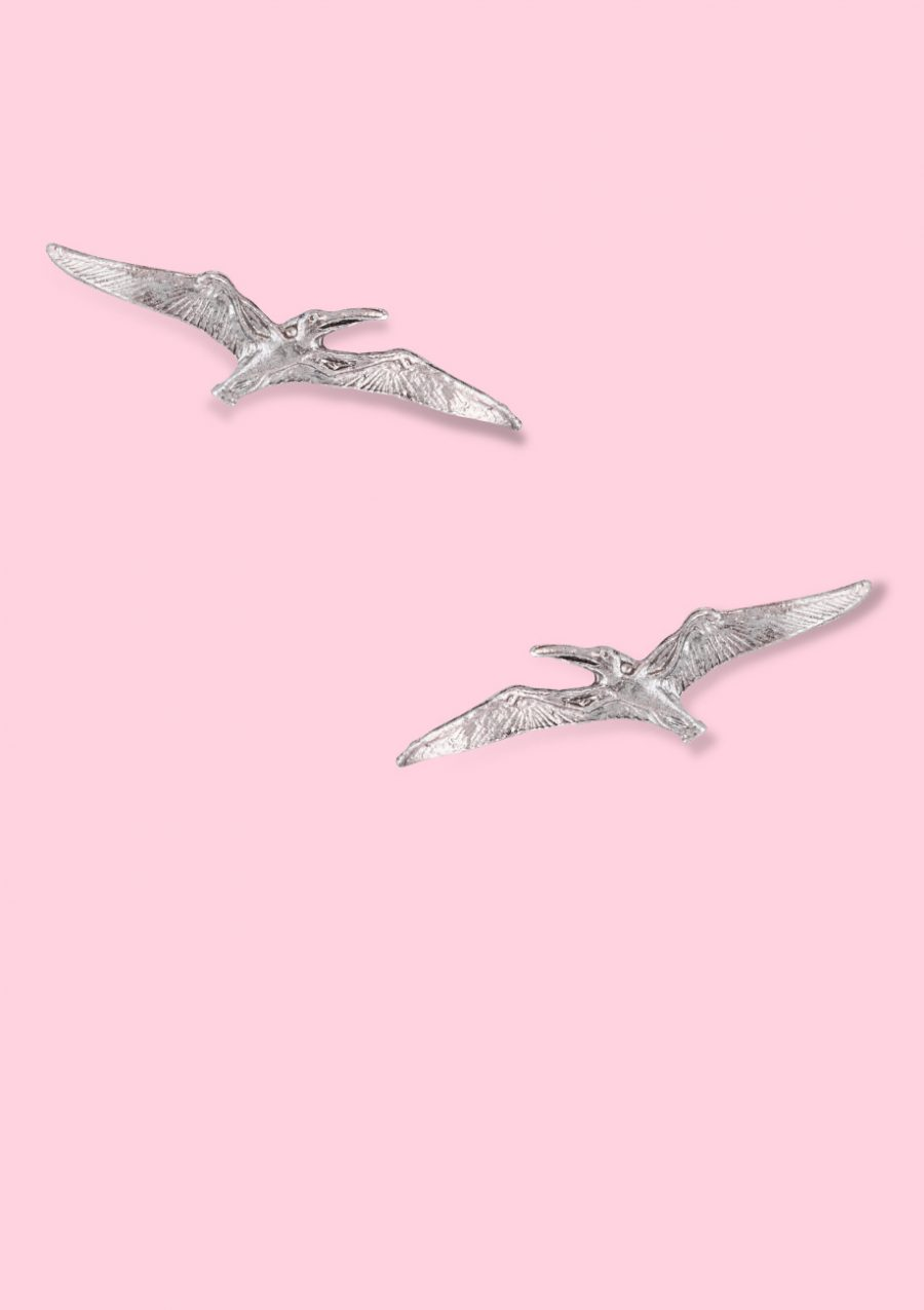 Dinosaur stud earrings with a push-back closing. Sustainable earrings by live-to-express.