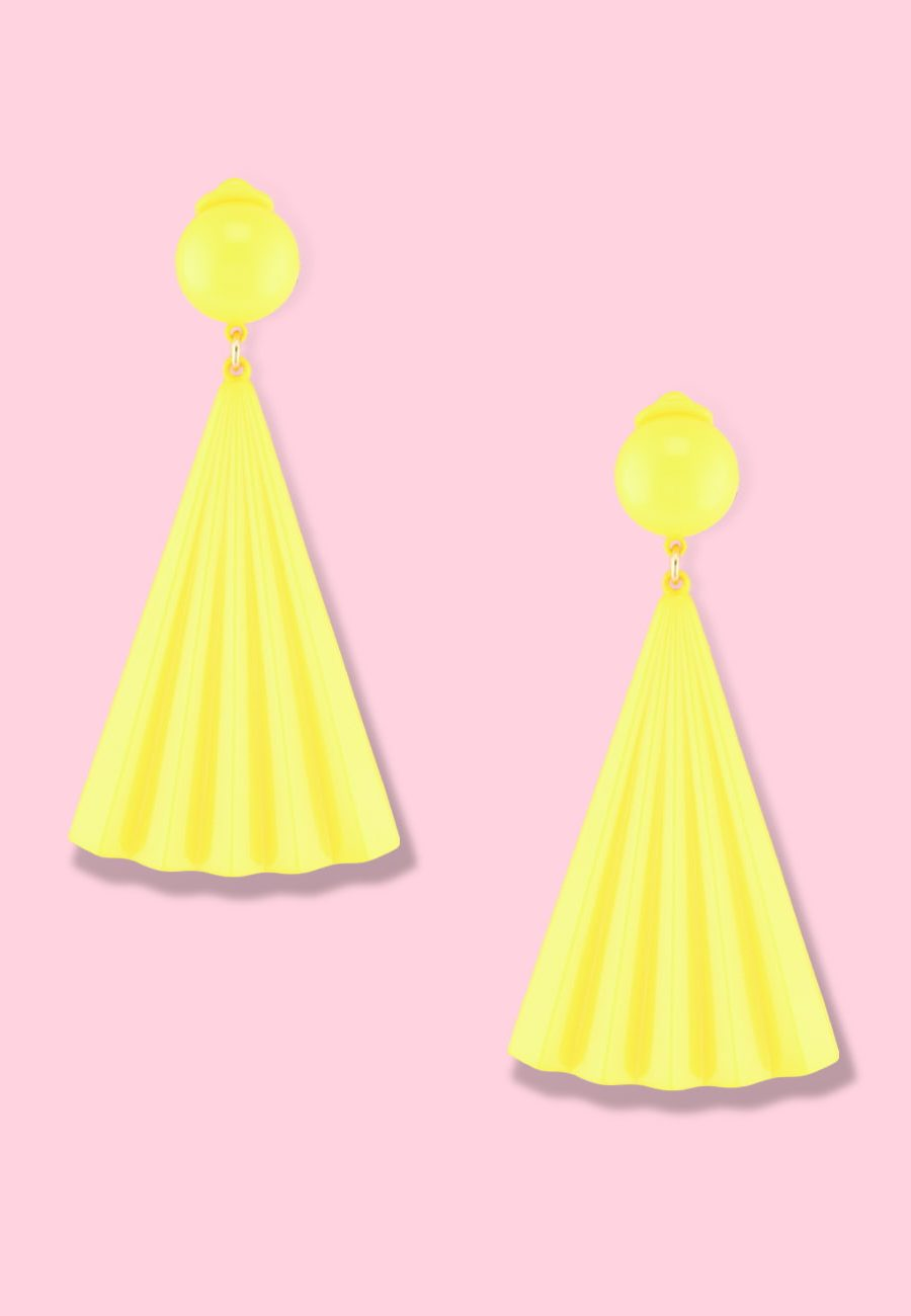 Yellow drop earrings by live-to-express. Shop 70's vintage clip-on earrings online.