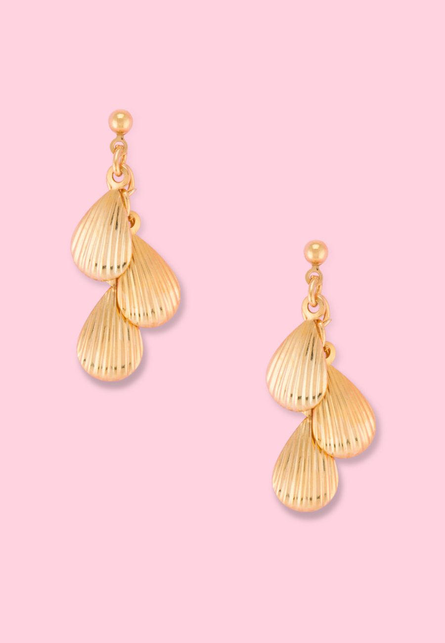 Golden shell drop earrings by live-to-express. Shop 90's vintage ear jewellery online.