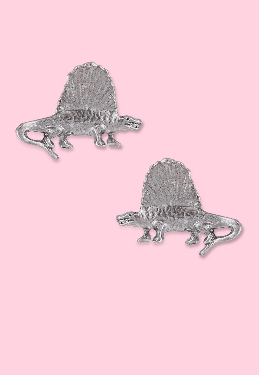 Dinosaurs stud earrings by live-to-express. Shop 90's vintage earrings online.