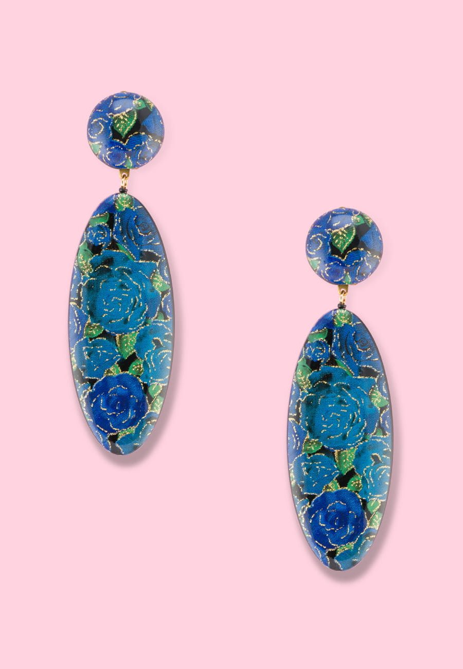 Blue floral glitter drop earrings by live-to-express. Shop vintage clip-on earrings online.
