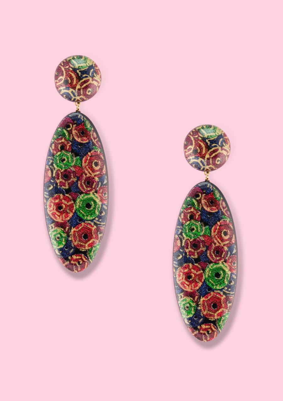 Red floral glitter drop earrings by live-to-express. Shop vintage clip-on earrings online.