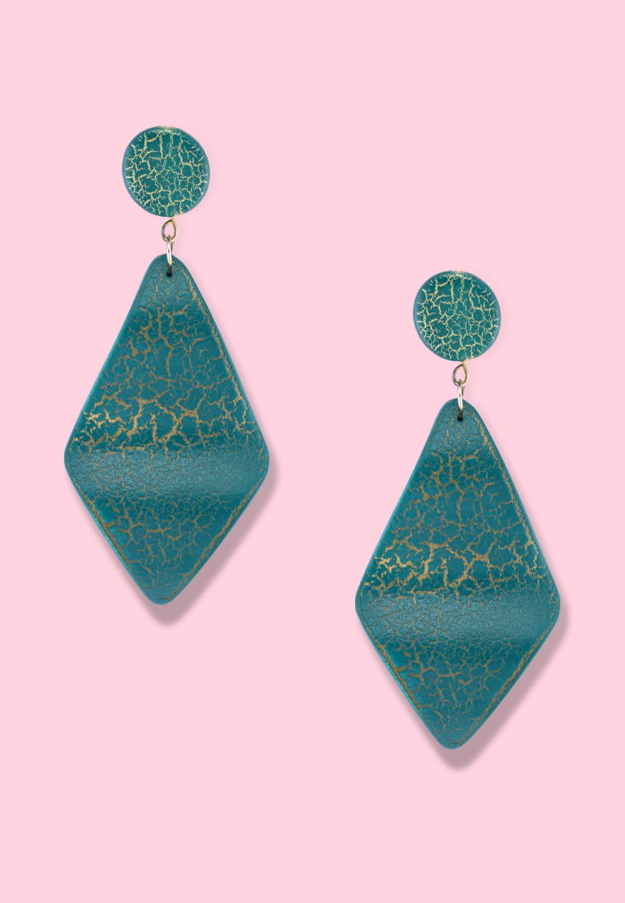 Green wooden drop earrings by live-to-express. Shop 70's vintage push-back earrings online.