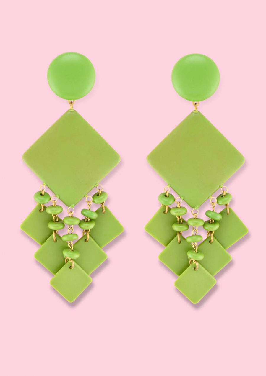 Green large statement earrings with clip-on closing by live-to-express. Shop 70's vintage earrings online.
