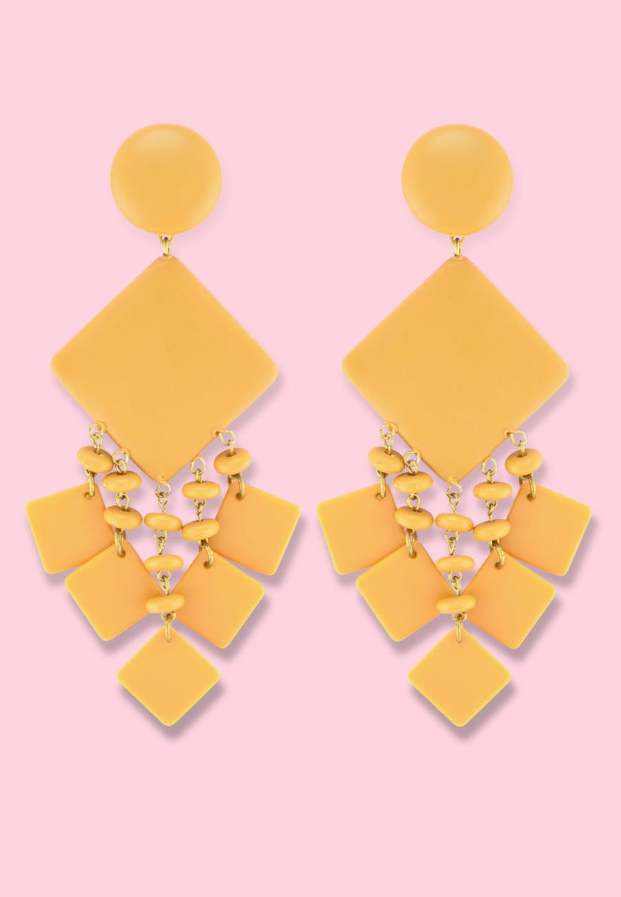 Yellow large statement earrings with clip-on closing by live-to-express. Shop 70's vintage earrings online.